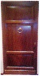 Foto portone da ingresso in legno di castagno